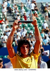 argentinas-juan-monaco-holds-up-the-trophy-after-beating-italys-alessio-gxmhrd